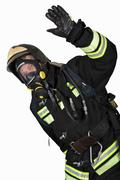 Firefighter in breathing apparatus gestures Ok Stock Photos