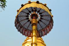 Golden umbrella, Buddhist Wat temple in Chiang Mai, Thailand - stock photo