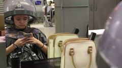 Asian woman at hairdresser having her hair dried whit hair steamer machine-Dan Stock Footage