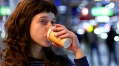 Brunette woman portrait drink coffee in public place Stock Footage