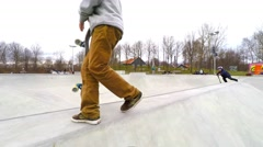 Having fun in the skaterpark where skateboards and scooters can be used Stock Footage