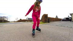 Girl learning to rollerskate Stock Footage