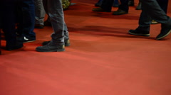 Steps of people at fair trade over red carpet Stock Footage