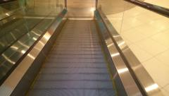 Escalator slowly moving down, reaching end, shopping mall, HD version Stock Footage