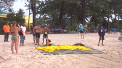 tourist befor paragliding at thailand beach water sport - stock footage