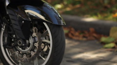 Close up of motorcycle wheel stops Stock Footage