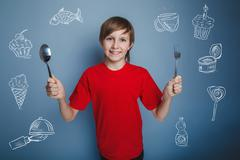 Teenager boy with a spoon and fork infographics lot of food coll Kuvituskuvat