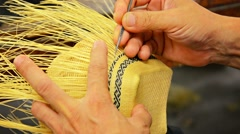 Local Artisan Creates Intricate Patterns in Straw Basket Stock Footage