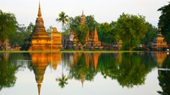 Ancient Buddhist Temples Reflected in a Pond Stock Footage