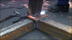 Welder at work in factory,real time, closeup Stock Footage