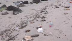Trash and junk on the beach environmental pollution Stock Footage