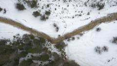 Aerial, vertical – River running through the winter woods Stock Footage