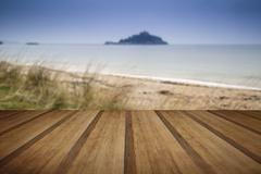 Island castle landscape viewed through sand dunes with wooden planks floor Stock Illustration