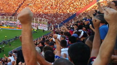 Argentine soccer audience in stadium celebrating goal - stock footage