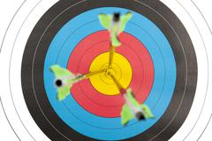 Archery target with arrows in short dept of field - stock photo