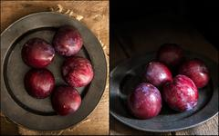 Compilation of images fresh plums in moody natural lighting set up with vinta Stock Photos