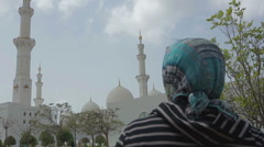 Woman in a scarf goes to the mosque - stock footage