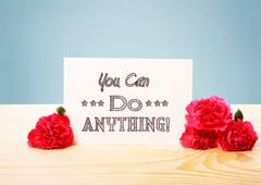 You Can Do Anything message with carnations - stock photo