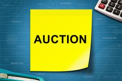 Auction word on yellow note Piirros
