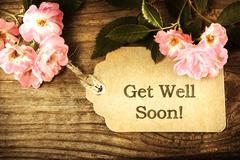 Get Well Soon message card with small roses Stock Photos