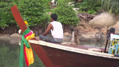 Thailand boat river side village Stock Footage