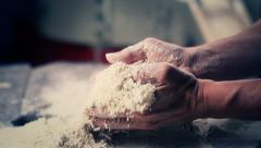 0642 Adult man hands working on flour over a millstone - stock footage