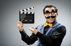 Funny man holding movie clapper Stock Photos