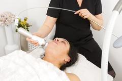 Woman get face treatment at beauty spa Stock Photos