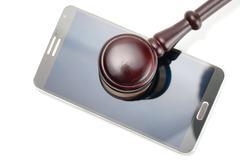 Smartphone under judge gavel - 1 to 1 ratio - stock photo