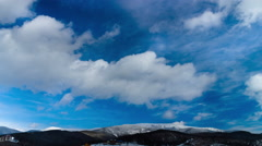 Clouds moving over the mountains. TimeLapse 4K Stock Footage