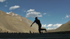 Boys playing cricket in the himalaya,Tabo,Spiti,India Stock Footage