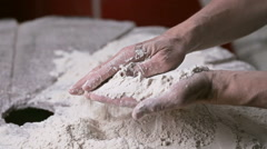 0644 Adult man hands working on flour over a millstone - stock footage