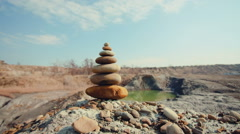 DOLLY MOTION: Stones balance. Spa or well-being, freedom and stability concept Stock Footage
