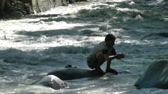 Man washing in river,Kargil,Ladakh,India Stock Footage