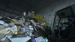 bulldozer pushes a large pile of paper recycling in slow motion - stock footage