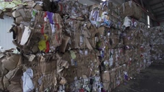 Baled paper in the warehouse for recycling of materials in slow motion Stock Footage