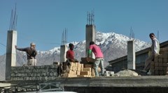 People working on house,Kargil,Ladakh,India Stock Footage