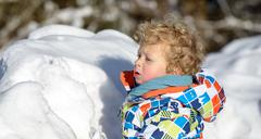 little 3 year old child  in the snow - stock photo