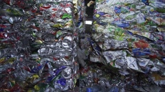 Compressed bale of aluminum cans for recycling in slow motion Stock Footage