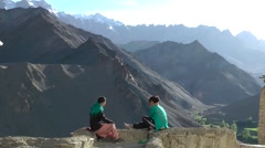 2 young ladies in discussion with mountain background,Lamayuru,Ladakh,India Stock Footage
