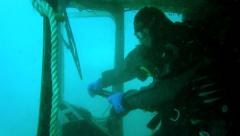 Underwater fun on a bus wreck - pretending to drive the bus! - stock footage