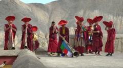Monks play horn on Lamayuru Gompa rooftop,Lamayuru,Ladakh,India Stock Footage