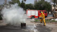 Firefighter extinguish fire during a drill Stock Footage