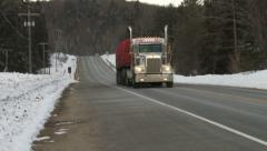 Truck driving on highway 60 in Algonquin Provincial Park Stock Footage