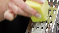 Grating cheese close up Stock Footage