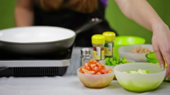 Adding onion in frying pan Stock Footage