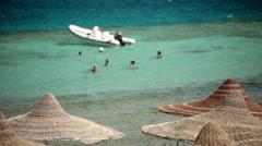 Resort travel tourists rest swim sea. Bright sun shining clear summer weather - stock footage