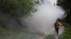 Firefighter walks near a cloud of smoke in the forest Stock Footage