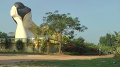 Big modern budha statue, man watering,Bago,Burma Stock Footage