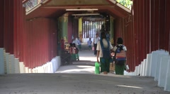 Kids walking on stairways to temple with roof,Bago,Burma Stock Footage